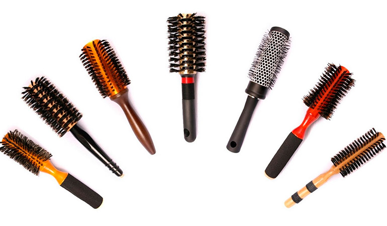 Hair dryer with comb attached